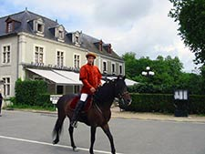 Man on horse near Chateau Chambord